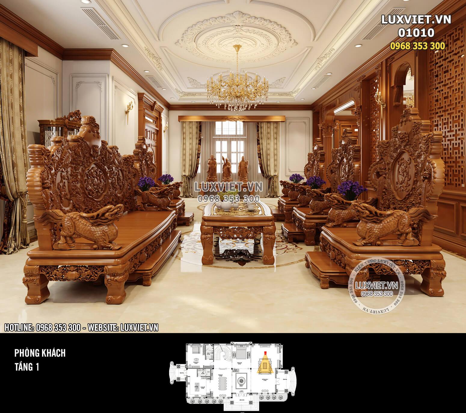 Hình ảnh: Phòng khách với bộ bàn ghế gỗ cầu kỳ và đẳng cấp